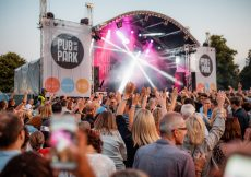 Pub in the Park Tunbridge Wells Kent, shot of the main stage with laser lights. The audience have their arms in the air
