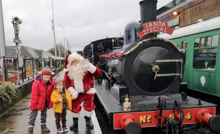 Two children with Father Christmas