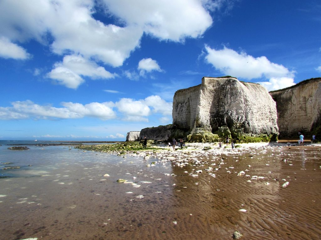 Botany Bay Beach, Broadstairs in Kent. A sandy beach at low tide with white cliffs in the background