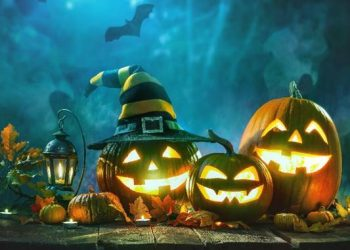 spooky Image of carved pumpkins, one in a witches hat