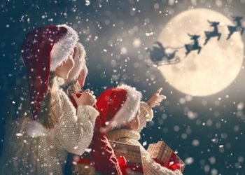 Children watcing father christmas fly over the moon